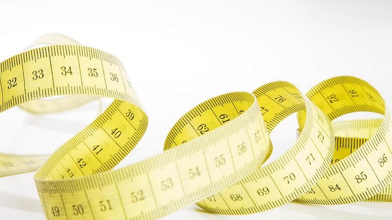 Maßband, Metermaß. Messung, Vermessung, Online-Werbung